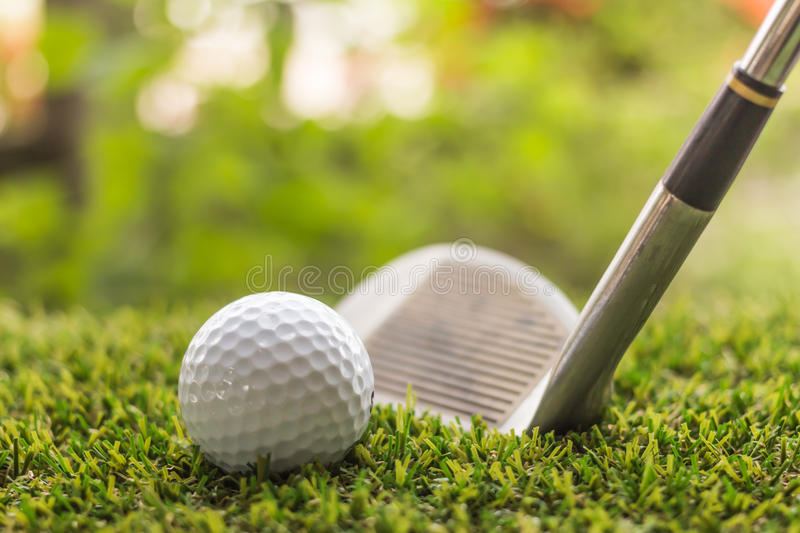 Golf club and ball on green grass. Individual sports stock image