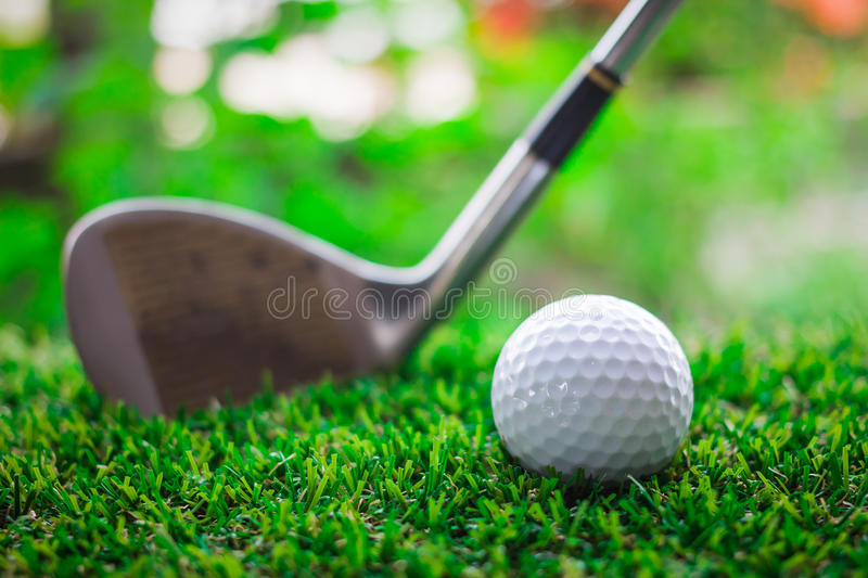 Golf club and ball on green grass. Individual sports stock photo