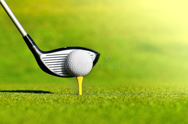 Golf club and ball on tee royalty free stock photography