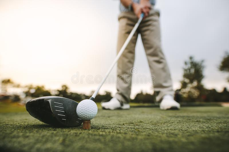 Golf club and golf ball on tee royalty free stock image