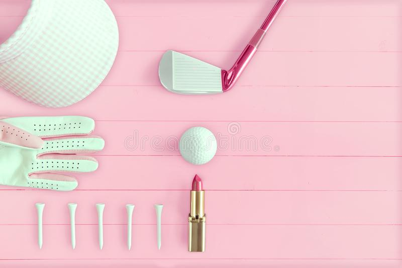 Golf club, golf ball, golf glove, tees and golf visor on pink wooden. Base from above, ladies day stock illustration