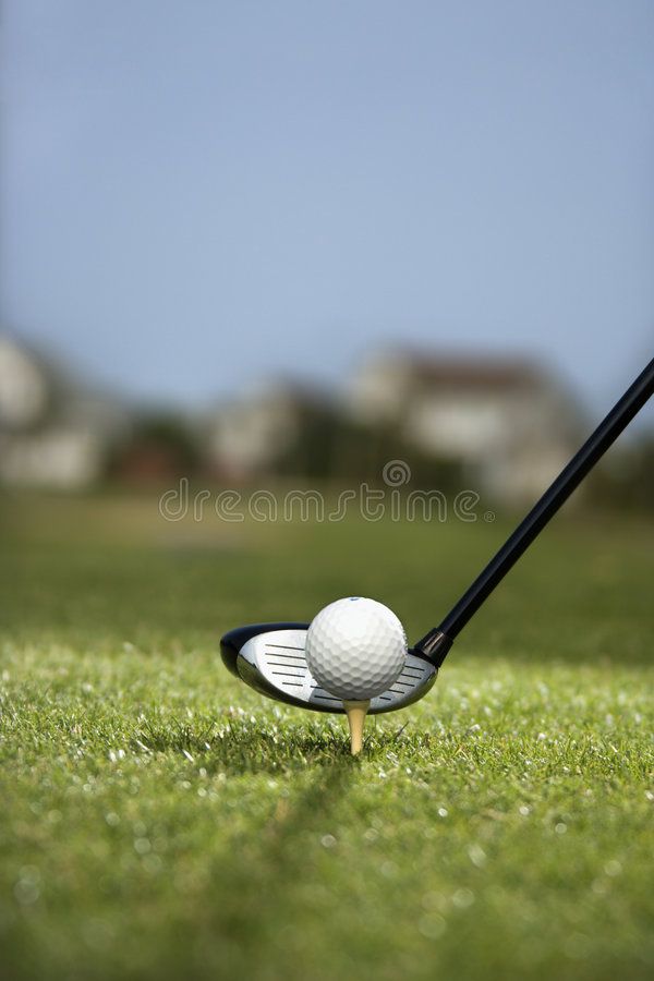 Golf club and golf ball on tee. royalty free stock photos
