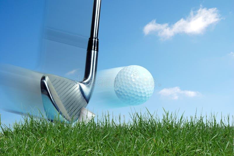 Golf club hitting ball stock photography