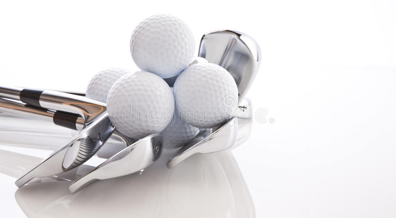 Golf Clubs and Balls. Golf Clubs in a pile with golf Balls royalty free stock photo