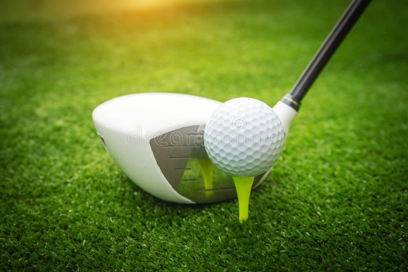 Golf clubs and golf balls on a green lawn in a beautiful golf course stock photos