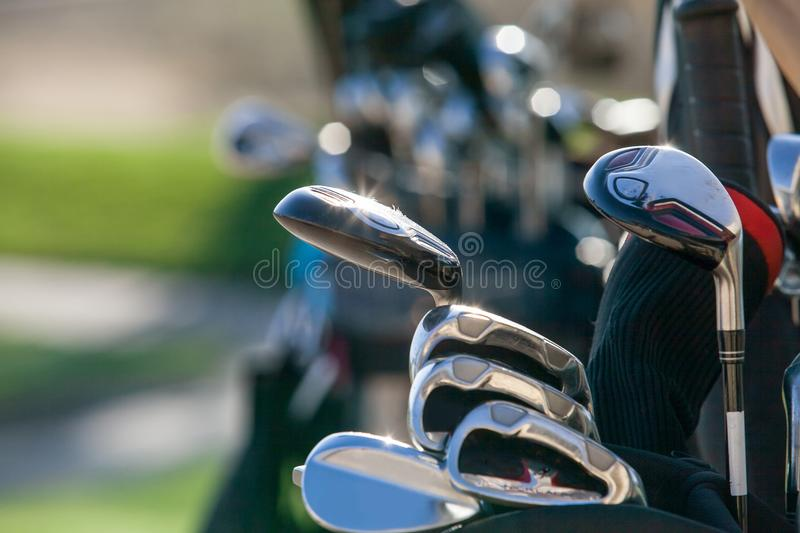 Golf Clubs in bright sunlight. Golf clubs glistening in the sunlight. A golf bag full of clubs. Golf club heads royalty free stock image