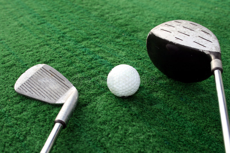 Golf clubs and golf ball stock image