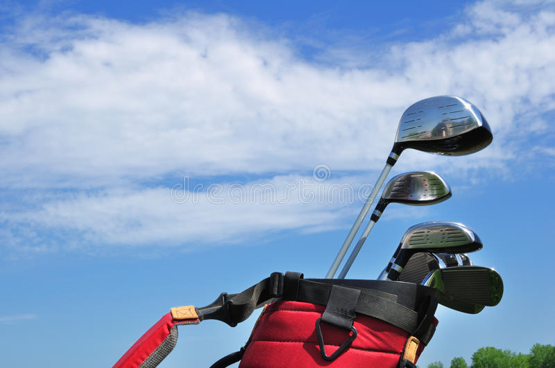 Golf Clubs in a Red Bag royalty free stock image