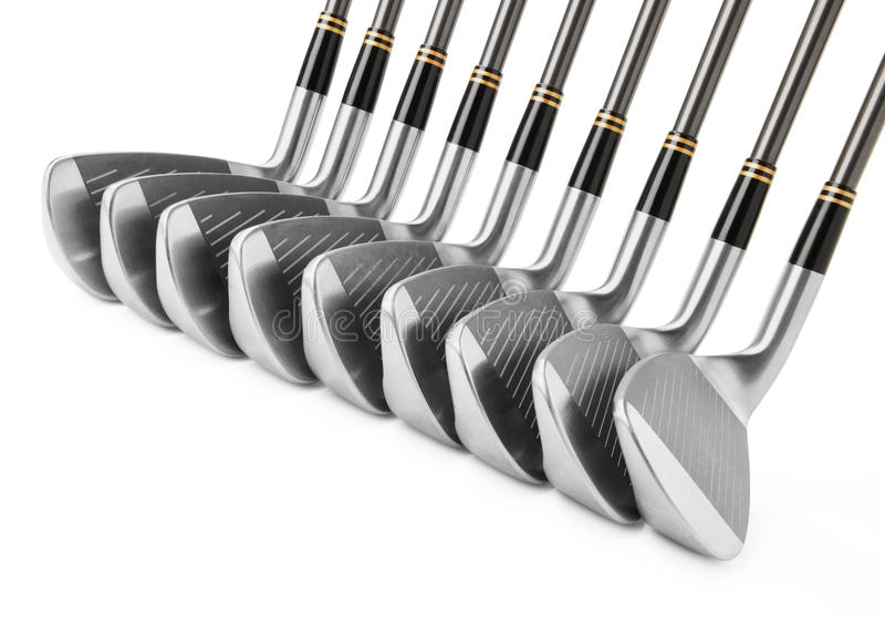 Golf clubs in a row stock photography