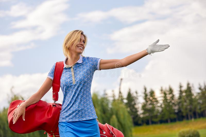 Golf concept, copy space. Women golf time holding golf equipment on green field background. The pursuit of excellence. Craftsmanship, royal sport, sports stock images