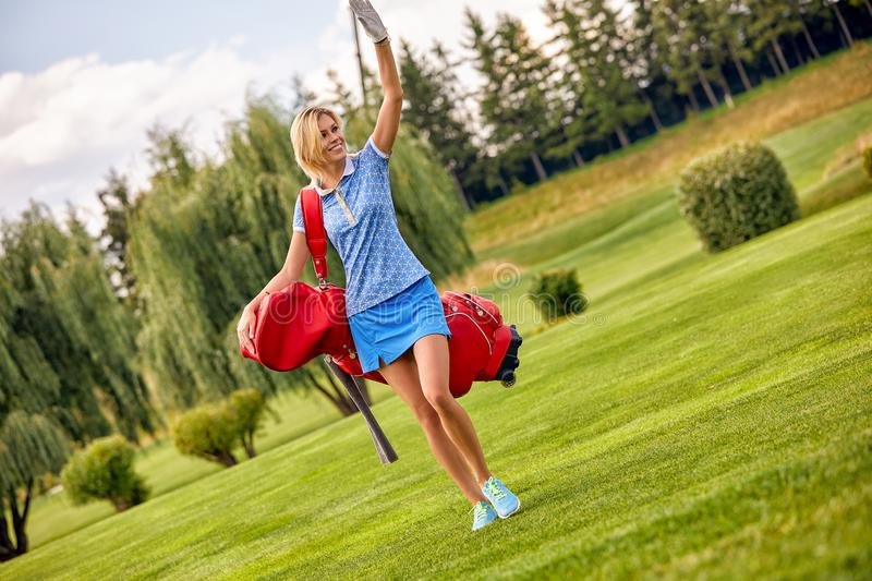 Golf concept, copy space. Women golf time holding golf equipment on green field background. The pursuit of excellence. Craftsmanship, royal sport, sports stock photography