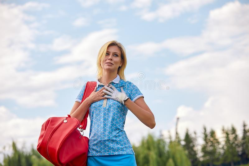 Golf concept, copy space. Women golf time holding golf equipment on green field background. The pursuit of excellence. Craftsmanship, royal sport, sports royalty free stock photos