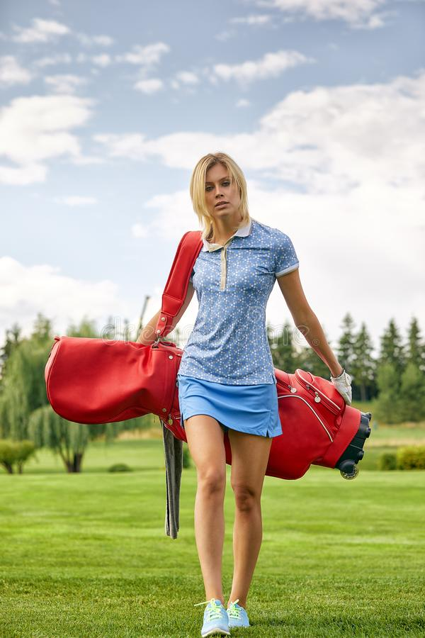 Golf concept, copy space. Women golf time holding golf equipment on green field background. The pursuit of excellence. Craftsmanship, royal sport, sports royalty free stock images
