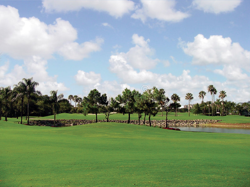 Download Golf Course stock photo. Image of builders, grass, clouds - 1073918