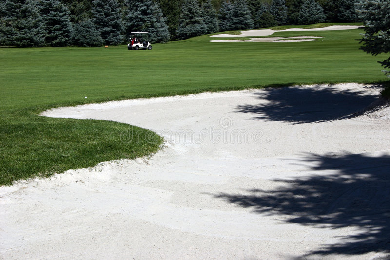 Golf Course. With cart and sand trap royalty free stock photos