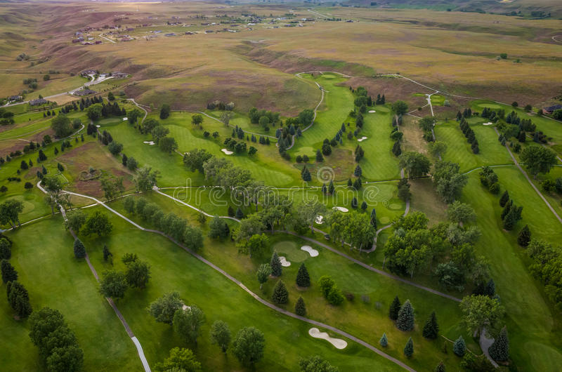 Golf Course Aerial. Aerial view of a beautiful green golf course royalty free stock photos