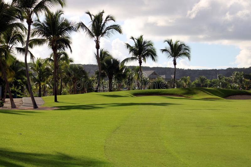 Golf course at Caribbean island with ocean in the back stock images