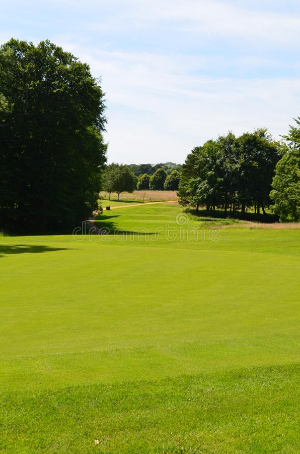 Golf course in England during Summer. Well kept professional golf course in Southern England during a Summers day royalty free stock photo