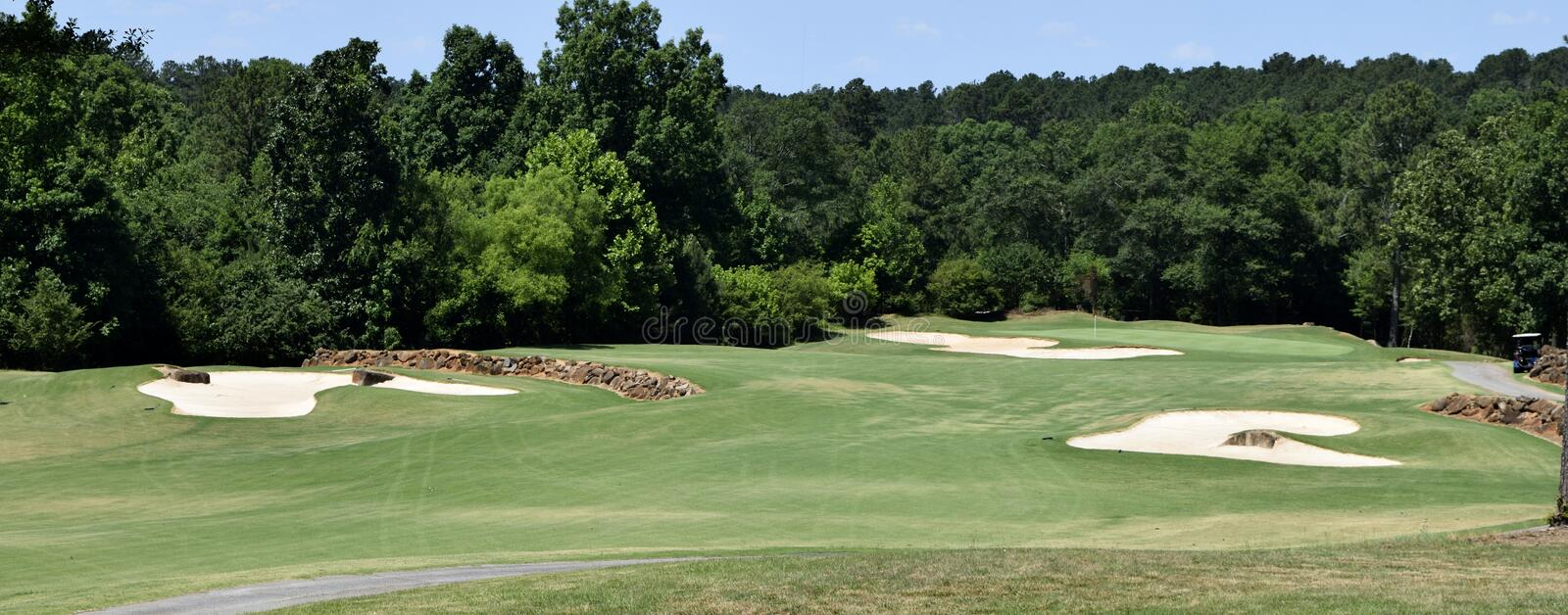 Golf course fairway and bunkers. Scenic view of golf course fairway with sand bunkers stock photo