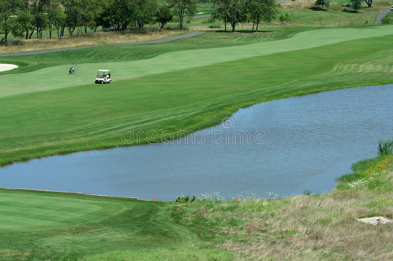 Golf Course Fairway With Water Hazard Royalty Free Stock Image