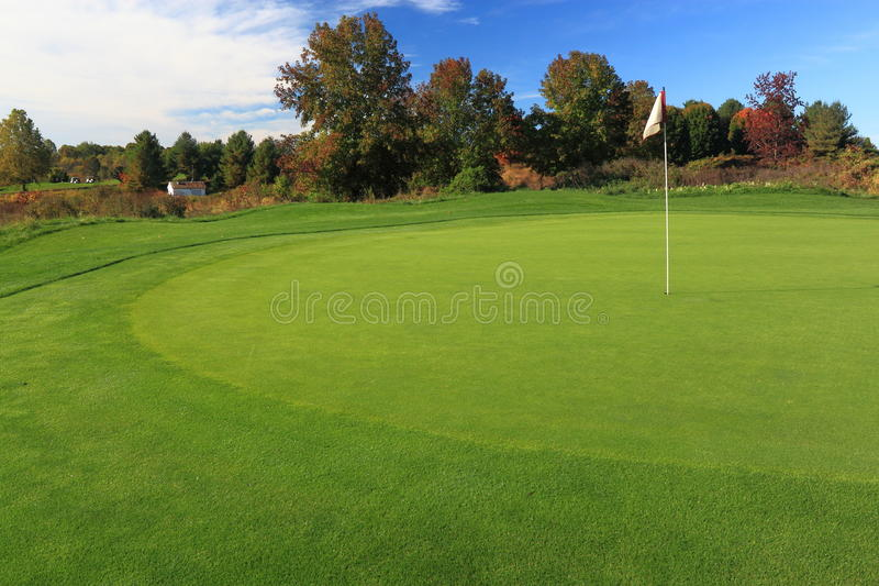 Golf Course with Flag. In autumn royalty free stock photo