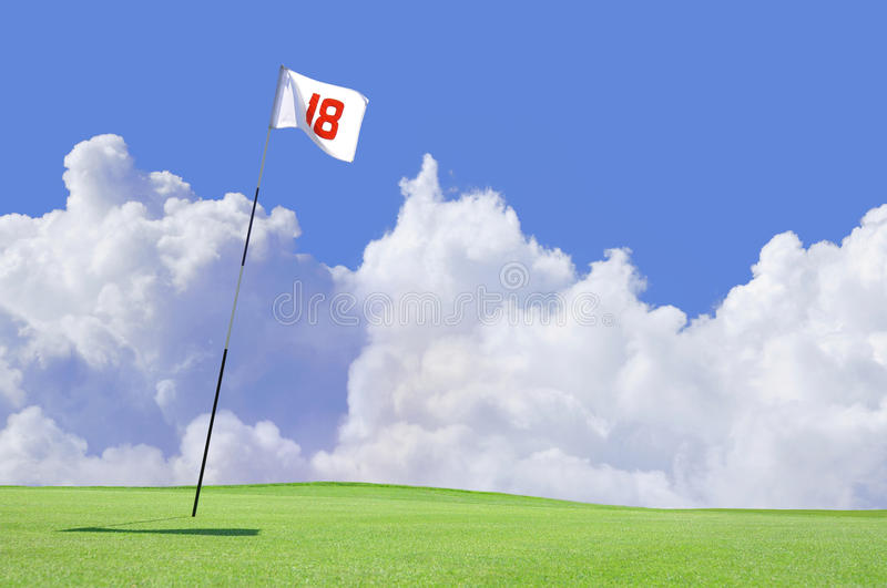 Golf course flag at hole 18 royalty free stock images