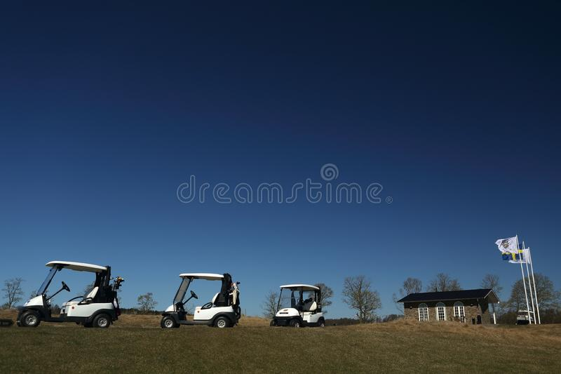 A golf course with golfcarts royalty free stock photo