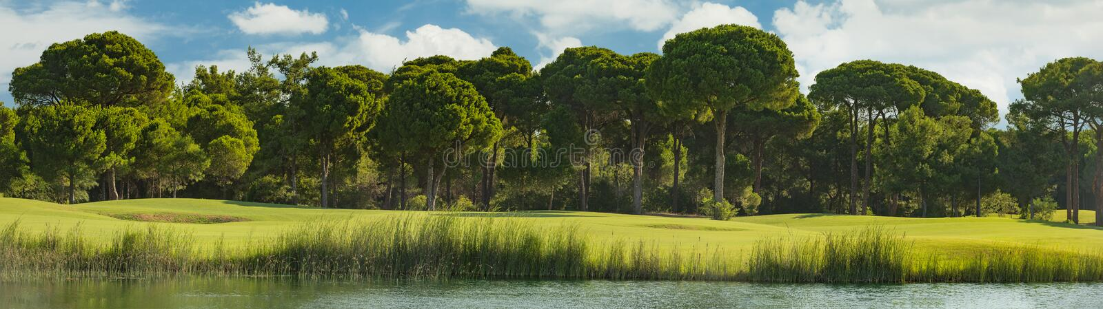 Golf course with lake royalty free stock image