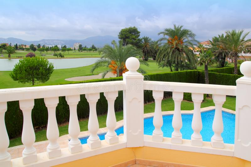 Golf course from pool housel white balustrade royalty free stock photography
