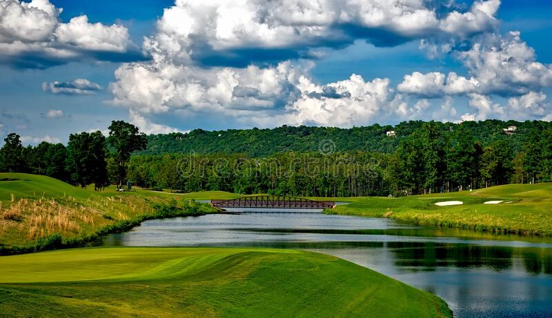 Golf course with river and clouds stock photos