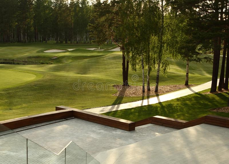 A golf course with roads, bunkers and ponds. And trees stock photo