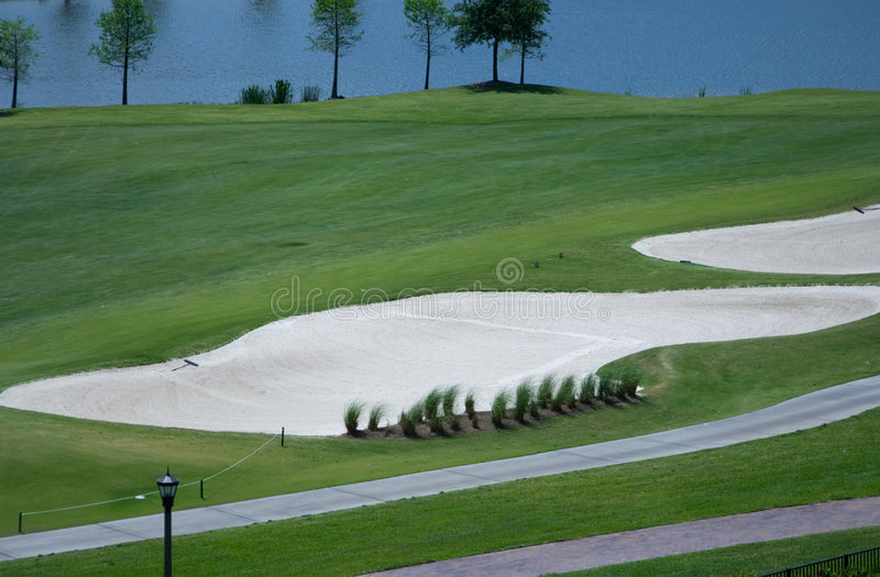 Golf Course Sand and Water Traps stock photography