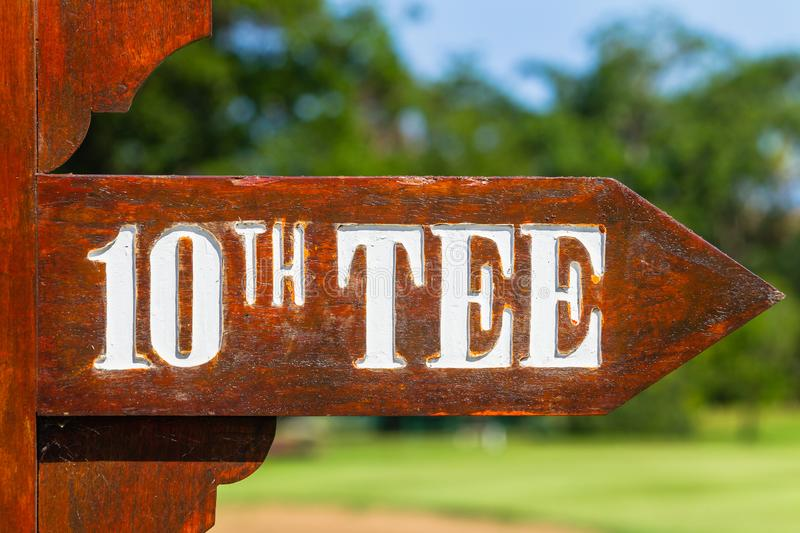 Golf Course Sign 10th Tee Directions. Golf course wood sign posting directions to 10th tee box for players stock image