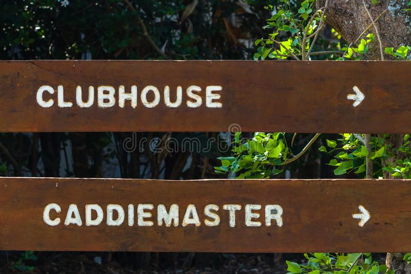 Golf Course Signs Clubhouse Caddie Master. Golf course worded direction signs clubhouse and caddie master directions on wood slat stock photo