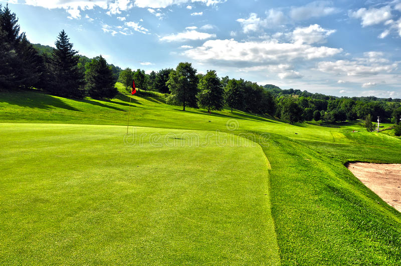 Golf course in a sunny summer day with clear sky stock images