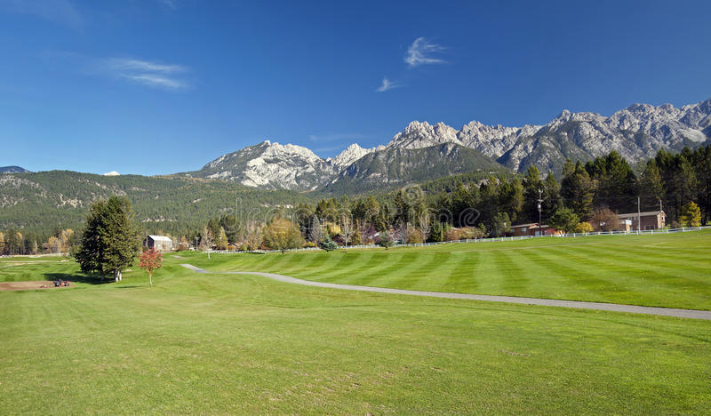Golf Course under Rocky Mountains royalty free stock images
