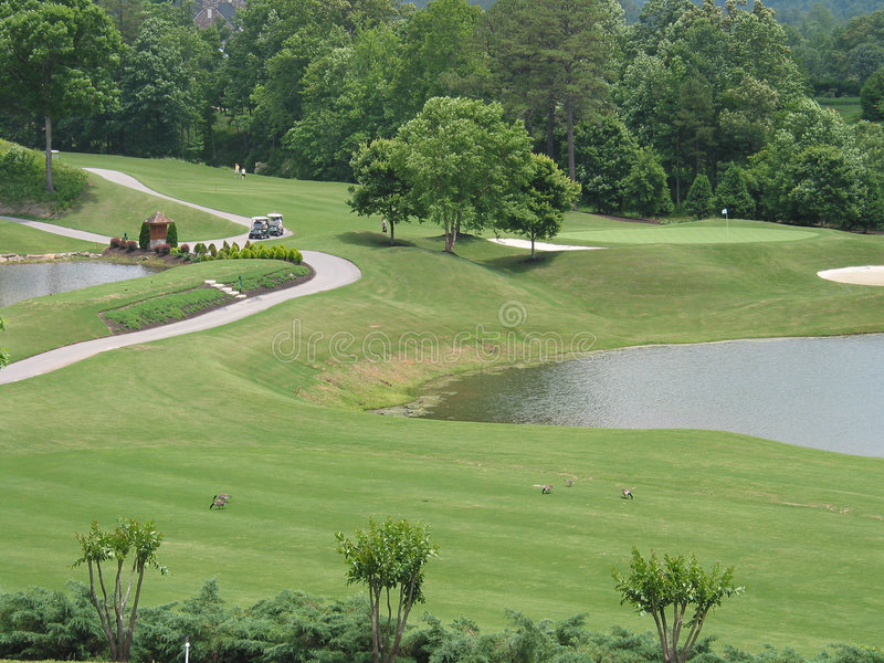 Golf course with water hazards royalty free stock photos