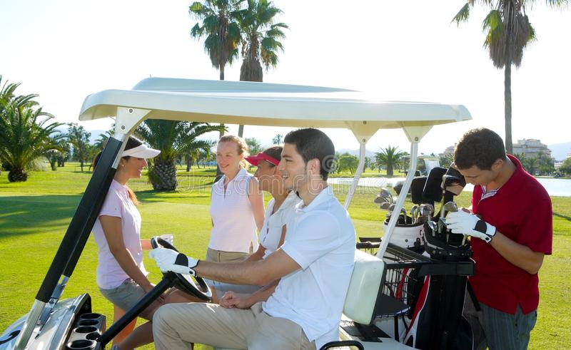 Golf course young people group buggy green field royalty free stock photo