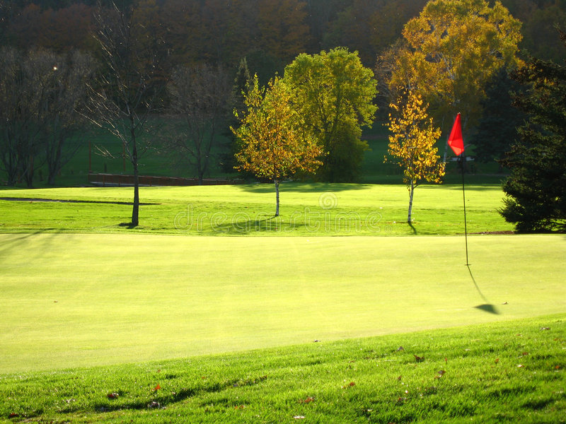 Golf court. At sunset, the 18th hole stock photography
