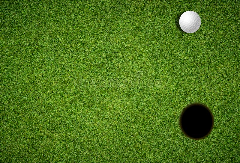 Golf day invitation, looking down on lawn with golf ball and hole royalty free stock photography