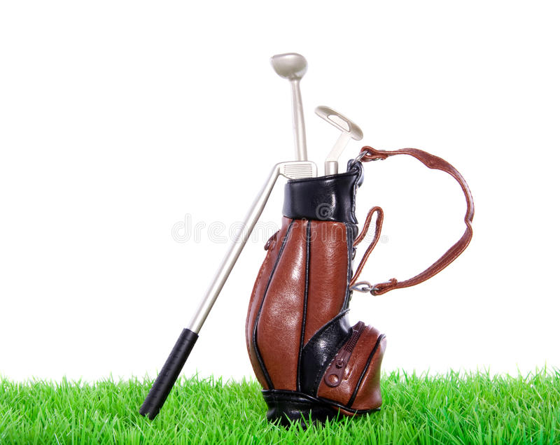 Golf equipment. In a leather bag on a green lawn isolated over white royalty free stock image