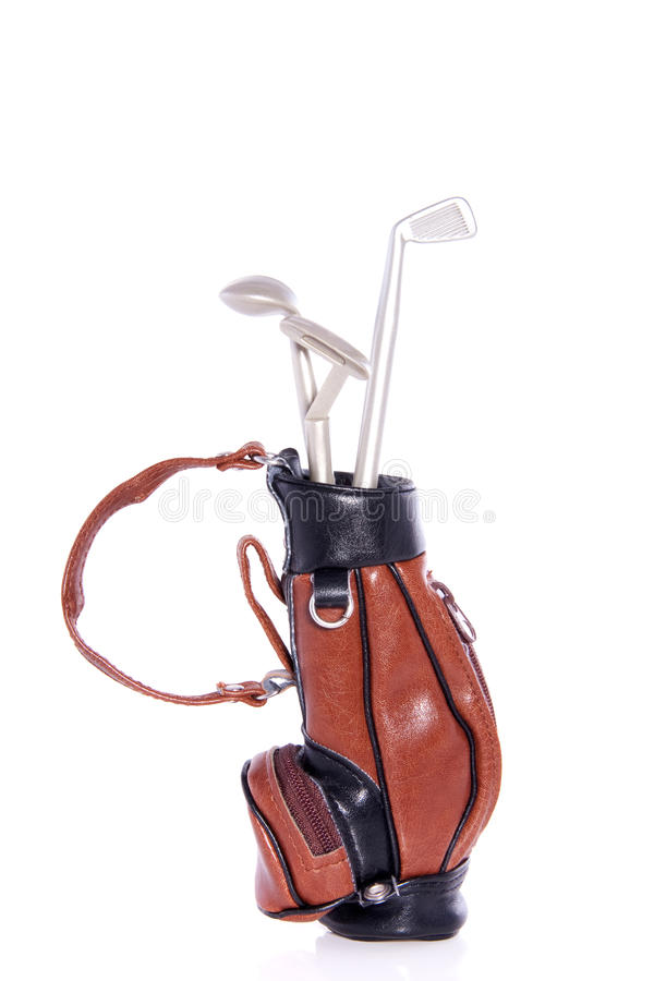 Golf equipment. In a leather bag isolated over white stock photos