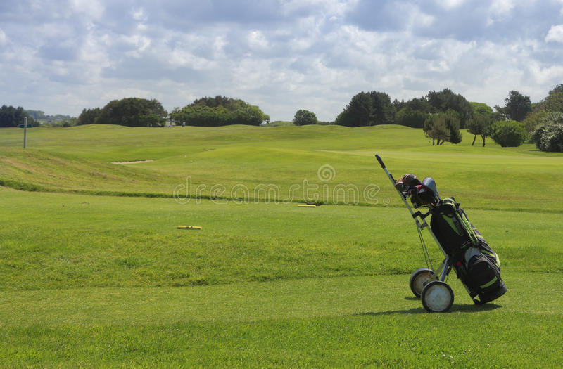 Golf equipment. On a golf field in a cloudy day royalty free stock image