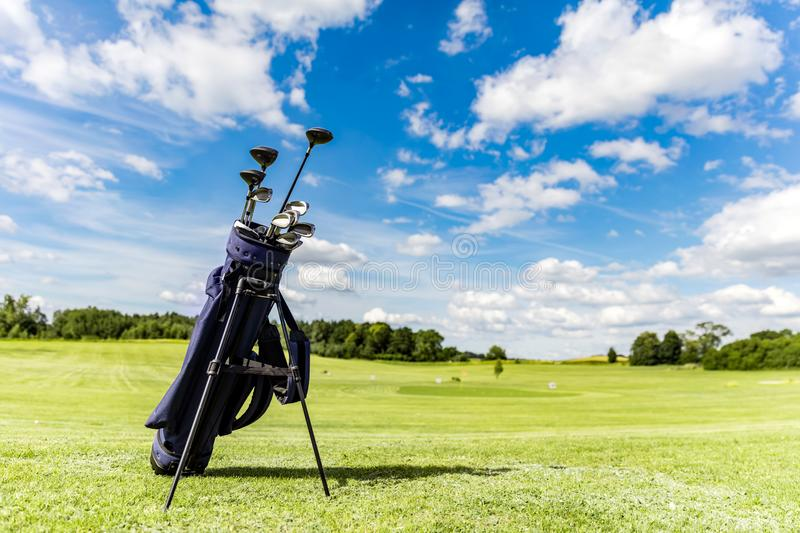 Golf equipment bag standing on a course. stock image