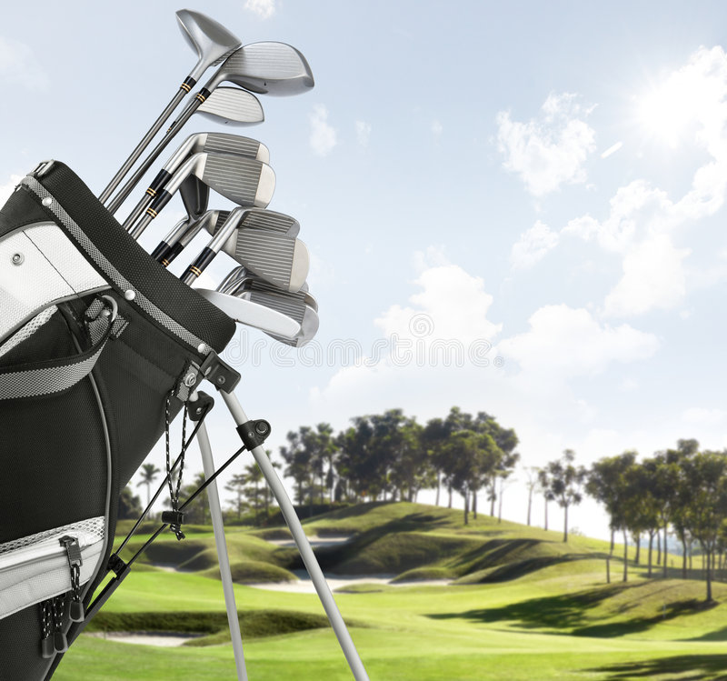 Golf equipment on the course. Close up of golf equipment, course as background stock image