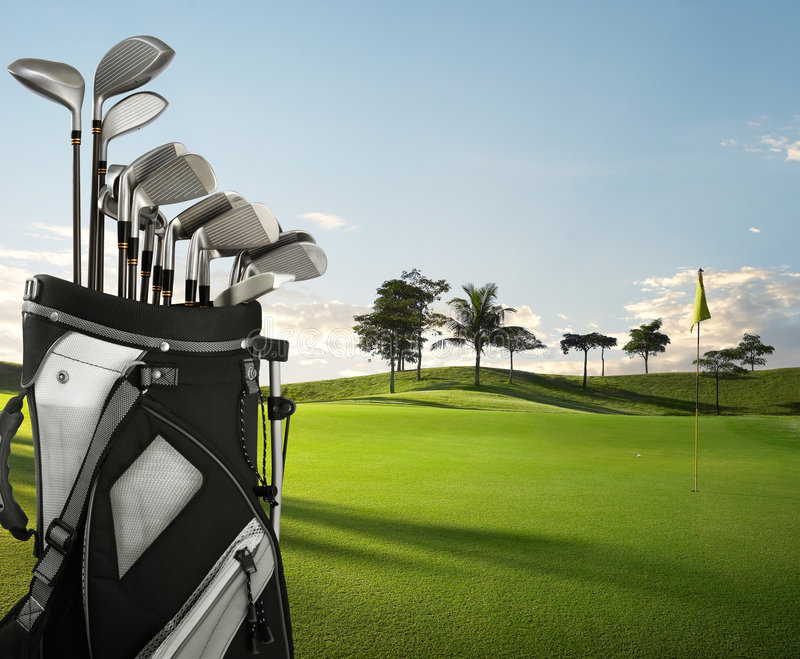 Golf equipment and course. Golf equipment on green and hole as background stock photo