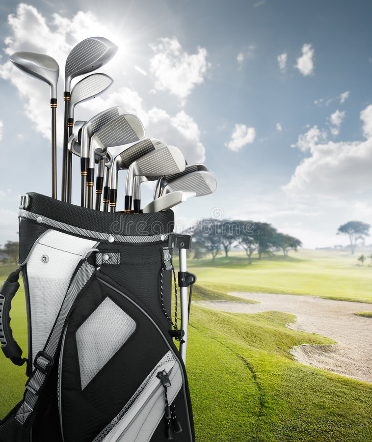 Golf equipment at the course. On sunny day stock image