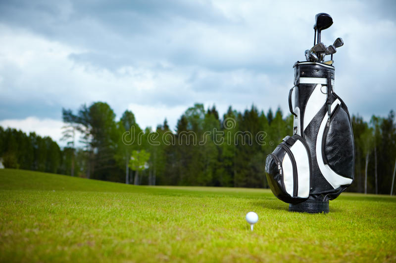 Golf equipment on green and hole stock images