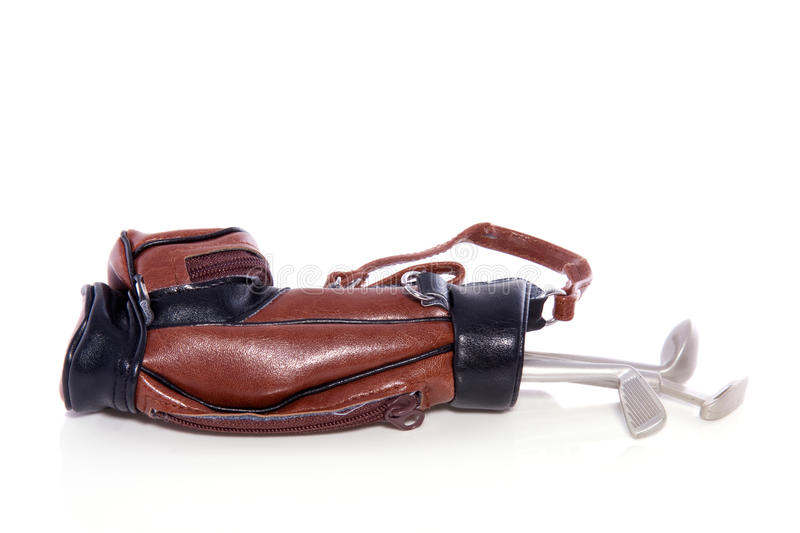 Golf equipment in a leather bag. Isolated over white stock images
