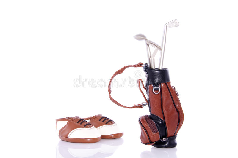 Golf equipment and shoes. Golf equipment in a leather bag isolated over white royalty free stock photography